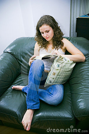 Woman in chair reading