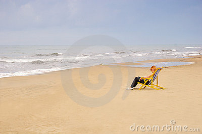 Woman in chair on sea beach