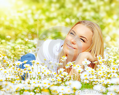 Woman in chamomile meadow