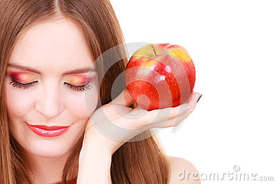 Woman charming girl colorful makeup holds apple fruit Stock Photo