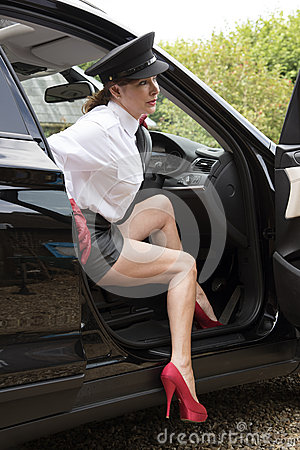 Woman chauffeur with sexy legs Stock Photo