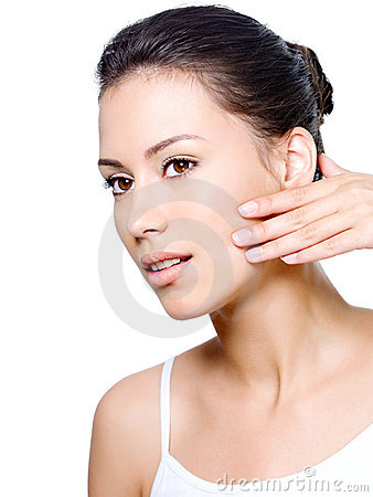 Woman checking creases on her face