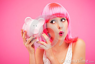 Woman checking her piggy bank