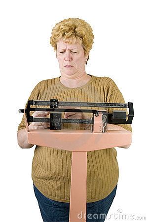 Woman checking her weight on scale with path