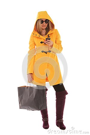 Woman checking messages while shopping