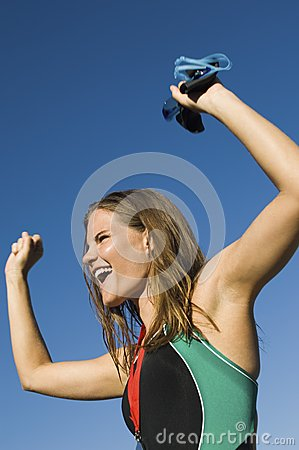 Woman Cheering With Arms Raised