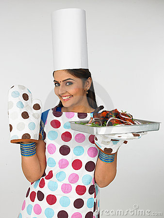Woman chef with baked chicken