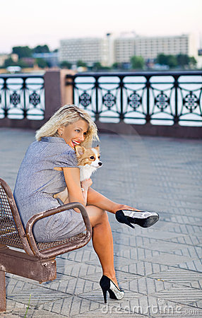 Woman with chihuahua.