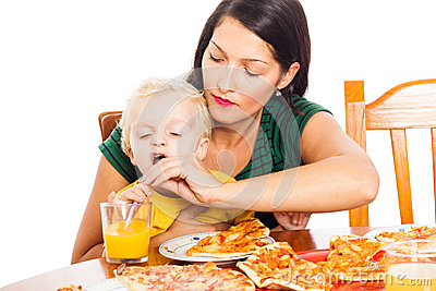 Woman with child drinking juice