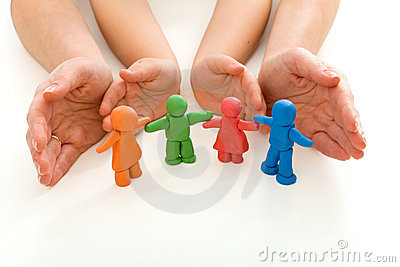 Woman and child hands protecting plasticine people