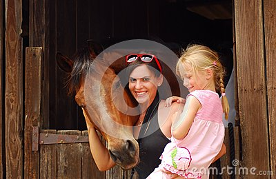 Woman and child with horse
