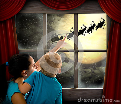 Woman with child pointing at Santa Claus