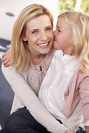 Woman and child pose in studio