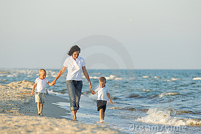 Woman and children at beach