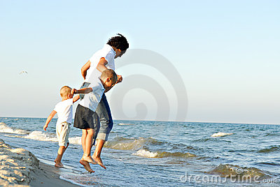 Woman and children in seawater