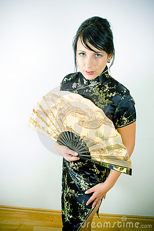 Woman in Chinese dress with fan