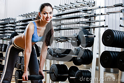 Woman chooses dumbbells