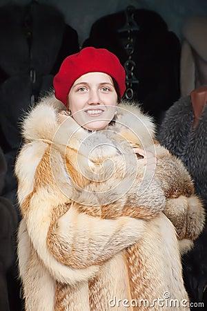 Woman  chooses fur coat