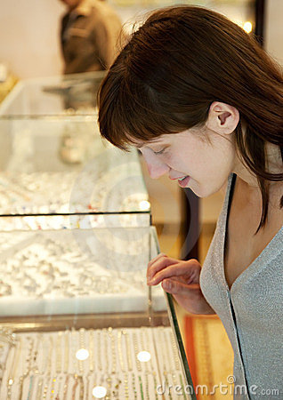 Woman  chooses jewelry