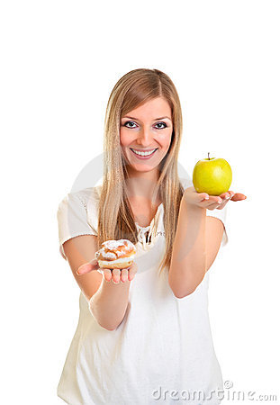 Woman choosing apple over puff