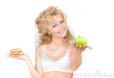 Woman choosing between burger and apple
