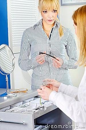 Woman choosing eyeglasses at optometrists