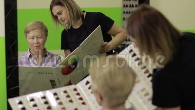 Woman choosing hair color from palette samples stock video footage