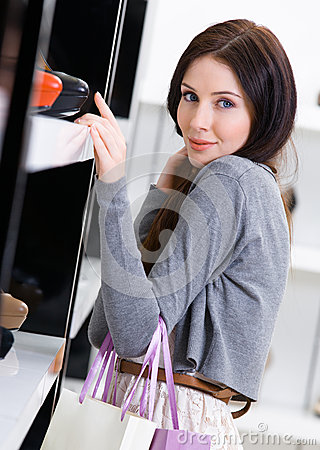 Woman choosing a pair of footwear in shop