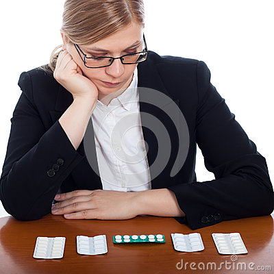 Woman choosing pharmaceuticals