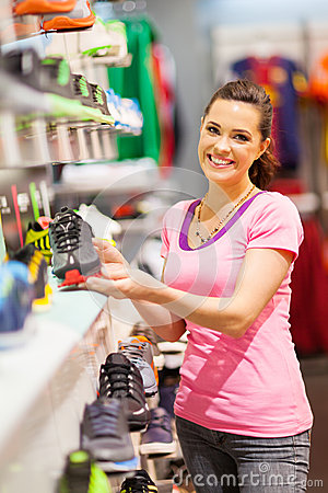 Woman choosing sports shoes