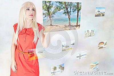 Woman choosing travel destination on touchscreen interface