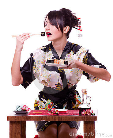 Woman with chopsticks and sushi roll