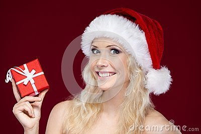 Woman in Christmas cap hands present