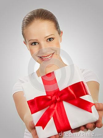 woman with a Christmas gift with red ribbon in t