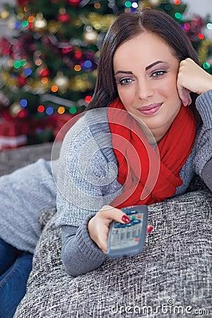 Woman on Christmas night watching TV