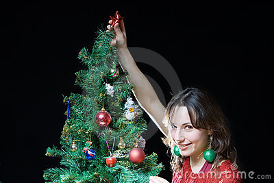 Woman and Christmas tree