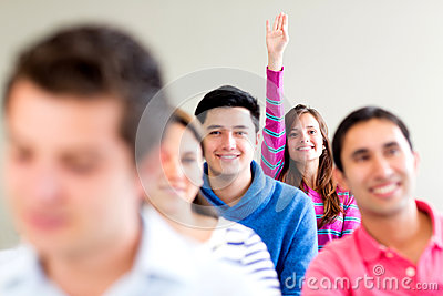 Woman in class raising her hand