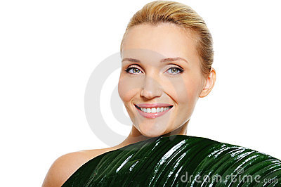 Woman with clean skin  and leaf cover her body