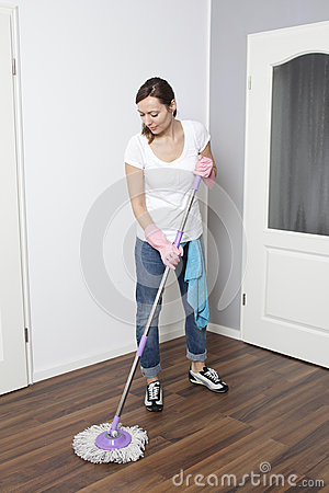 Woman cleaning the flat
