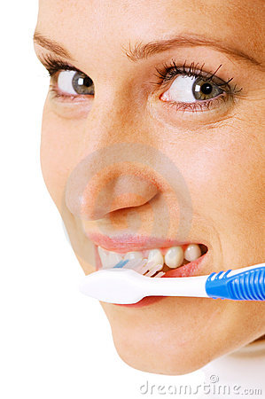 Woman cleaning her teeth at the morning