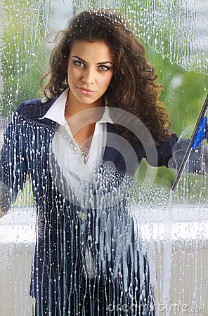 Woman cleaning her windows