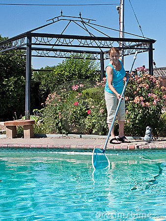 Woman cleaning swimming pool