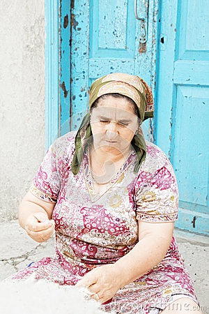 Woman cleaning wool