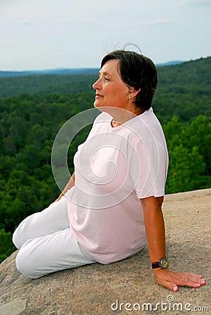 Woman at cliff edge
