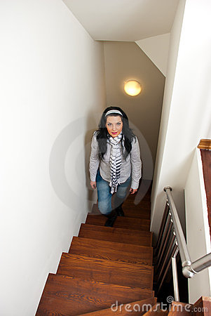Woman climb interior stairs