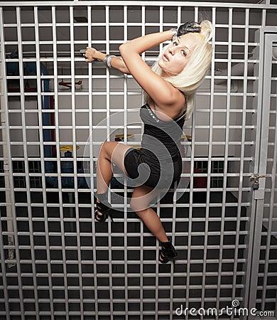 Woman climbing in distress