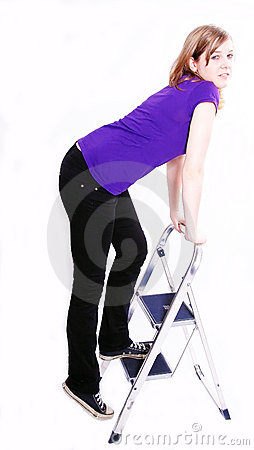 Woman climbing a ladder