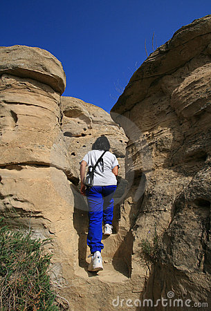 Woman Climbing Stairs in Badlands