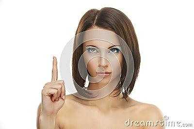 Woman close-up index finger raised