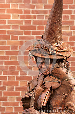 Woman in clothes of Witch on the Halloween Fair Editorial Stock Photo
